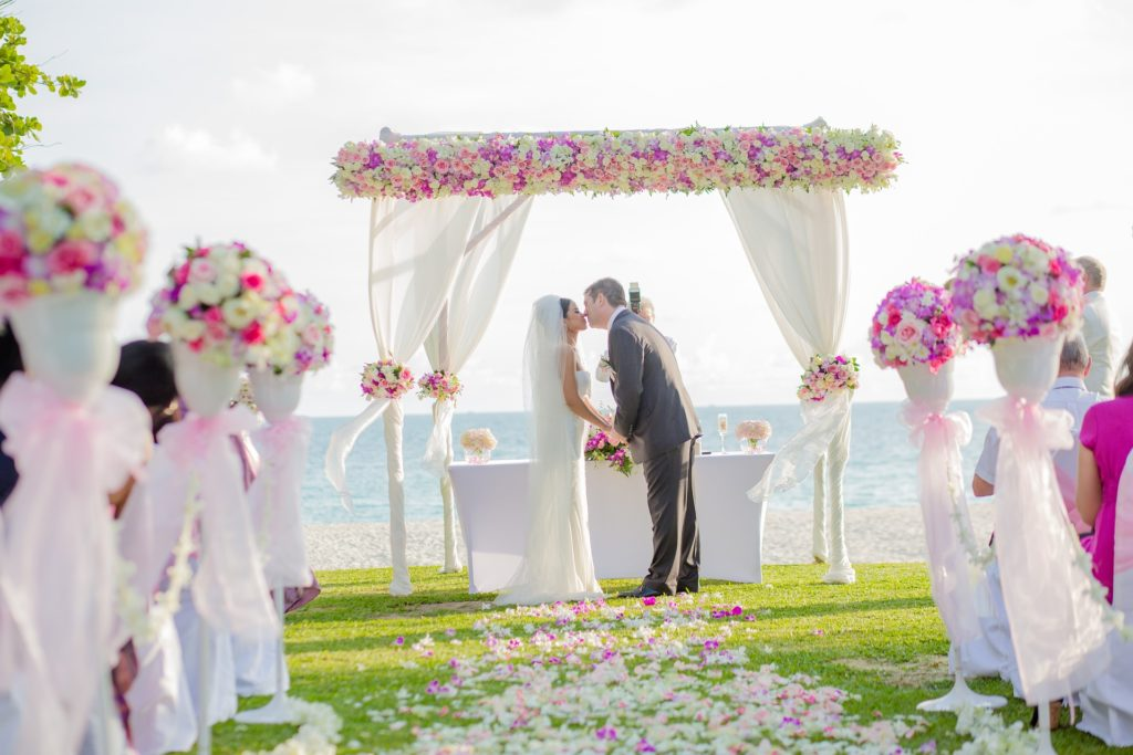 flower archway, destination wedding ceremony